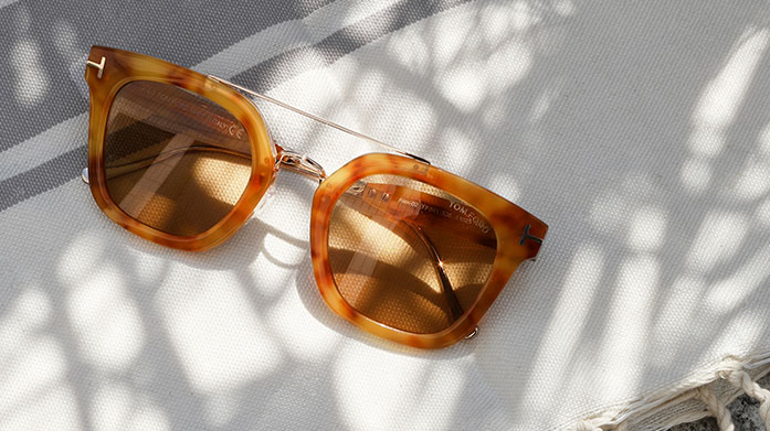 Sunshine Designer Sunglasses for Her  Choose a new pair of designer shades for summer from our curated edit of sunglasses by Ray-Ban, Prada, Tom Ford and Chloe.