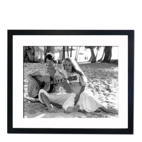 51 DNA Mick Jagger Strumming with Jerry Hall 1983, Framed Art Print