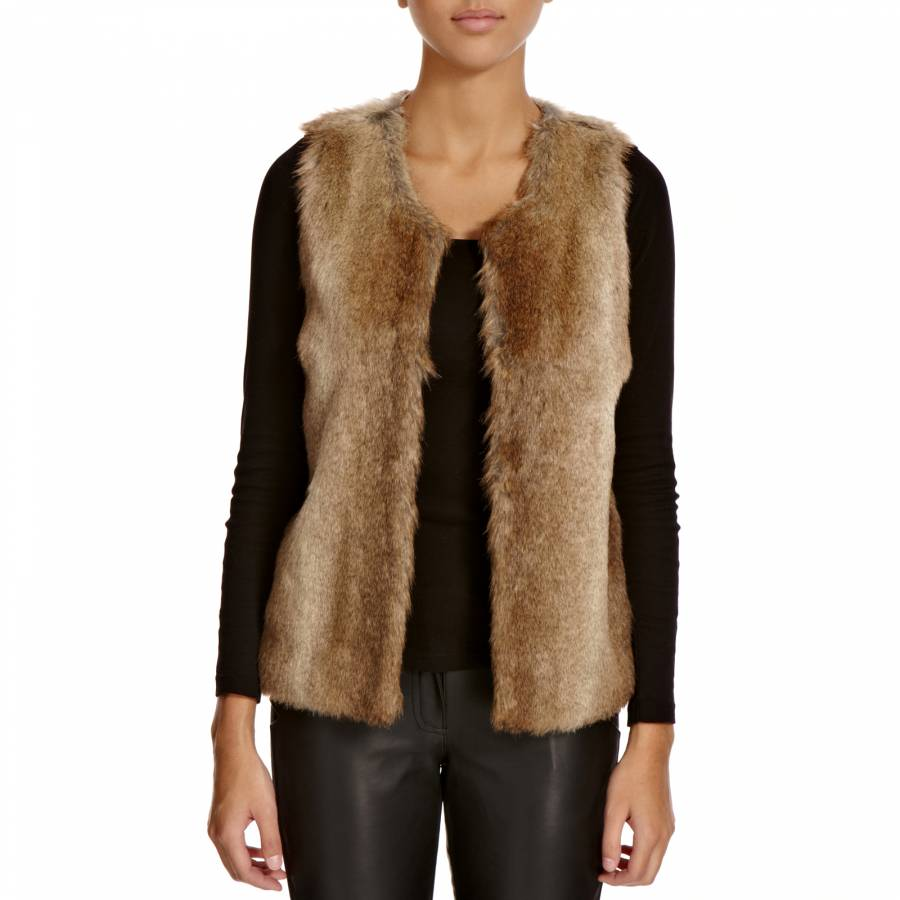 Add a dose of boho chic to your winter look with this fun-'n'-funky open-front gilet. It's crafted of unlined chunky knit fabric and has a large flower-type design on the back and front chest; the hem, waist and collar are trimmed with thick faux fur.
