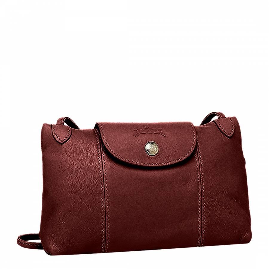 a0befa4eda Longchamp Burgundy Le Pliage Leather Crossbody Bag. prev. next. Zoom