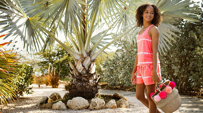 Tiny Tropics Summertime means flower power! Shop children's clothing including babygrows, dresses and swimwear in a range of tropical prints!