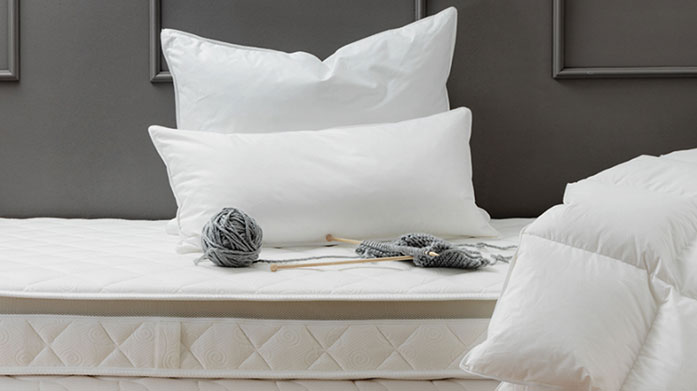 Surrey Down Duvets & Pillows  Sink into luxuriously soft, feather filled pillows and duvets for ultimate comfort and warmth in the cold winter months.