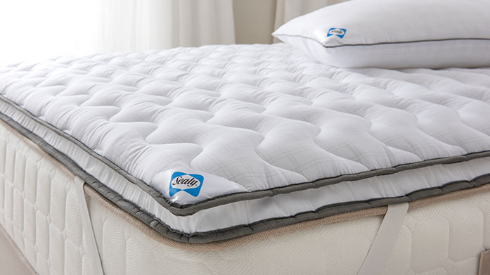 Sealy Duvets, Pillows & Toppers Using comfort enhancing technology, Seal's range of duvets, pillows and mattress toppers offers everything you need for a restful night's sleep.