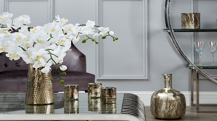 Chelsea Townhouse Home Accents Mirror the chic interior of a London townhouse with glass vases, table lamps, metallic ornaments and other stylish decorative accessories.