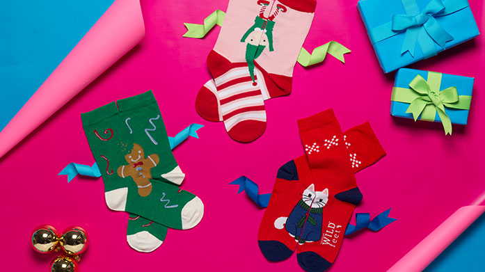 Women's Sock Gifts Socks don't have to be boring! Choose her a luxury pair of stylish socks or cosy slippers for Christmas by Lulu Guinness, Wild Feet or Pringle.