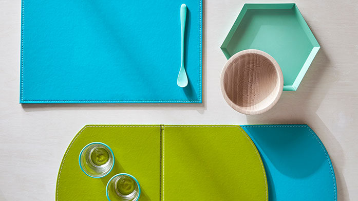 FreeForm Inject some personality into your home with these colourful kitchen trays and placemats in a range of designs.