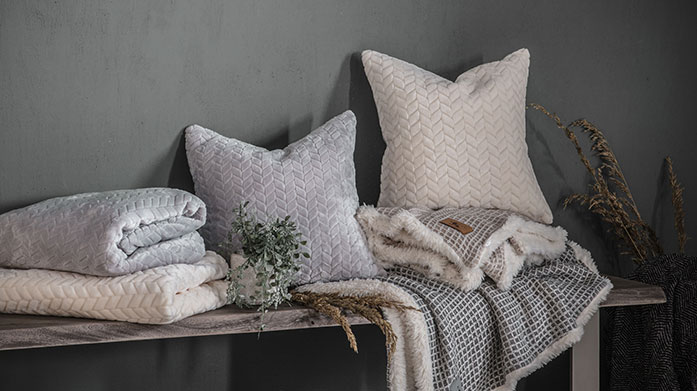 Cosy Throws & Cushions Blissfully soft fleece throws and faux fur cushions to make your winter nights a warm and cosy affair...