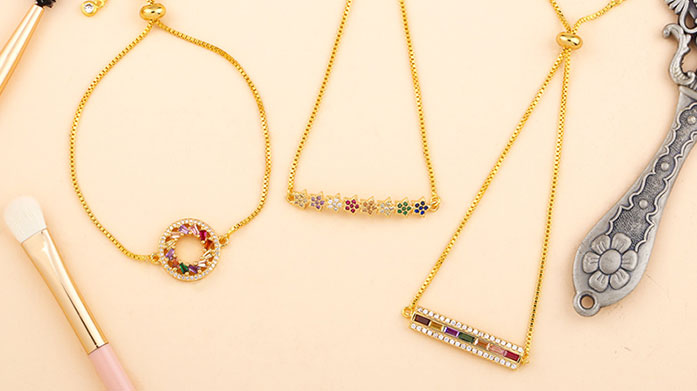 Conversational Jewellery Pieces Add some personality to your outfits with this edit of colourful jewellery, including rainbow earrings and bejwelled necklaces!