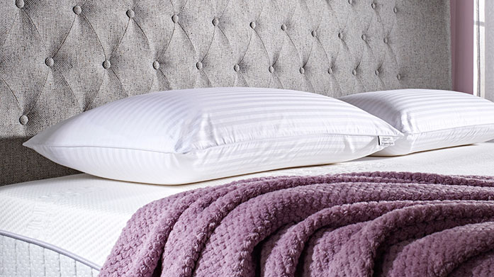 Dunlopillo Pillows Enhance your night's sleep with a ultra-comfortable Dunlopillo pillow, offering instant pressure relief with a soft washable cover.