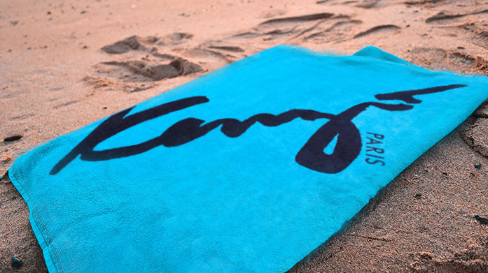 Kenzo Beach Towels Kenzo beach towels are the perfect choice for a day by the pool or at the beach, thanks to their rich cotton fabric and bold designs.