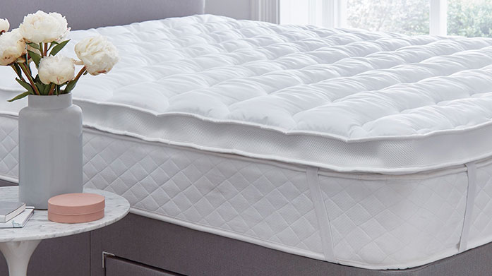 Comfort-Enhancing Bedding Enhance your night's sleep with posturpedic pillows, temperature regulating mattress toppers and super cosy duvets.